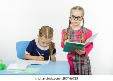 Two girls play school teacher and student
