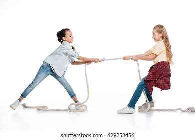 Two girls play tug of war, kids sport isolated concept