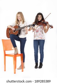 Two girls playing musical instruments