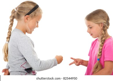 two girls playing rock-paper-scissors before white background