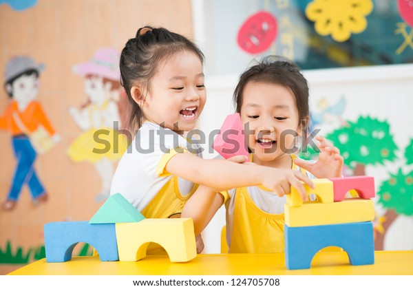 Two girls playing in the studio