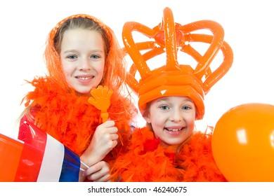 Two girls are posing in orange outfit for soccer game or queensday over white background
