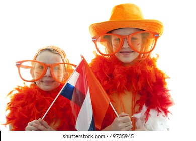 Two girls posing in orange outfit for soccer game or Dutch Queensday over white background