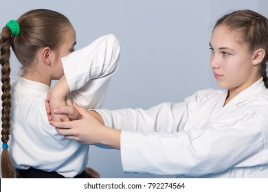 Two girls practice Aikido
