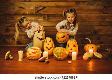 Two girls preparing for the holiday Halloween. Night, candles, pumpkin, tales.