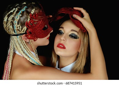 Two Girls in red masks