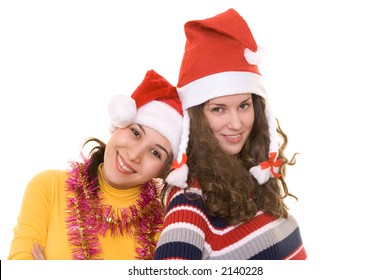 Two girls in santa's hats having fun on christmas