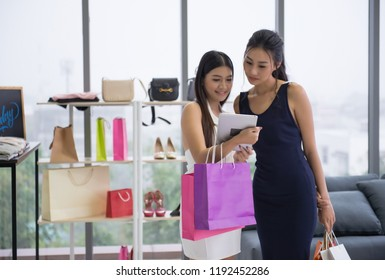 Two girls are shopping in Clothing store. They trying to choose nice dress for herself. Many girls loved to shopping every time when they are happy, stress or sad. That's what the girl wants.