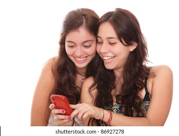 two girls smiling and seeing in cell phone  , white background. photography