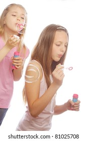 two girls with soap bubbles