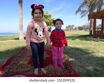 Two girls standing on the shore of the Arabian Gulf in Saudi Arabia Jubail Industrial City in the summer of 2018