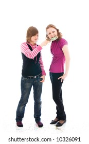 The two girls with a sugar candy isolated on a white background