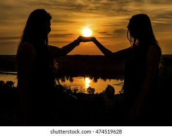 Two girls and sunset in Kazimierz Dolny, Poland - Shutterstock ID 474519628