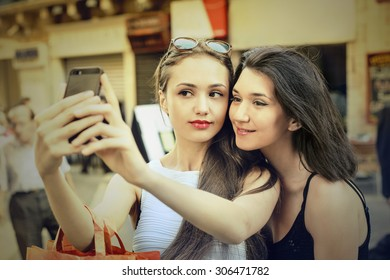 Two girls taking a picture of themselves