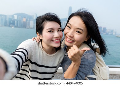 Two girls taking self image together