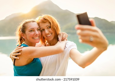 Two girls taking self photograph