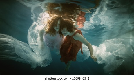 Two girls under the water