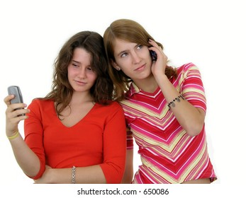 Two girls using mobile phones