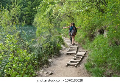 Two girls walking on the wooden paths in Plitvice Lakes National Park in Croatia