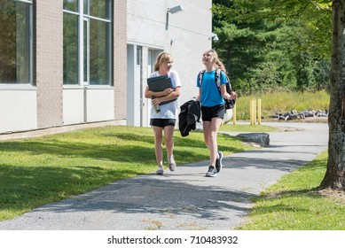 Two girls walking to school.