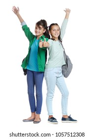 Two girls  wearing  casual outfit showing thumbs up