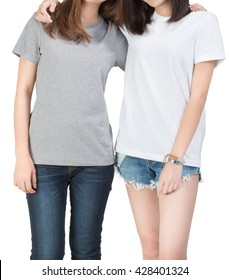 Two girls wearing t-shirt with white background. Clipping path