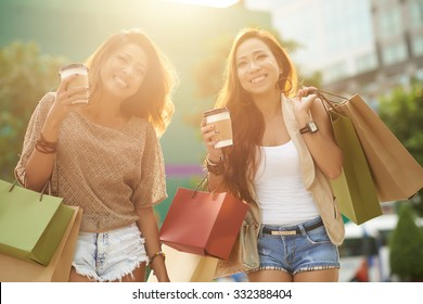 Two glamorous Asian women shopping together