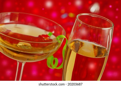 Two glases of champagne with red background