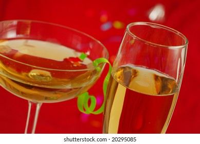 Two glasess of champagne with red background