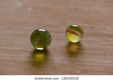 Two glass balls close up.