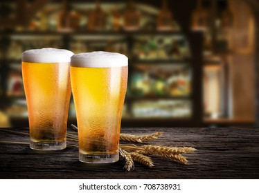 Two glass of beer with wheat on wooden table with copy space
