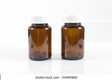 Two glass bottles of medicines on white background