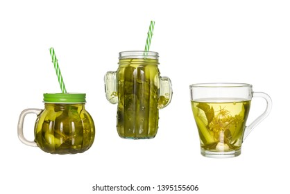 Two glass jars with a straw and a glass of cucumber pickle isolated on white background