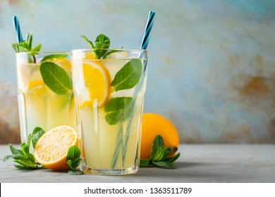 Two glass with lemonade or mojito cocktail. With copy space.