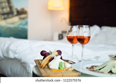 Two glass of rose wine, cheese board and carpaccio (selective focus)
