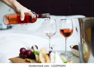 Two glass of rose wine and cheese board (selective focus)