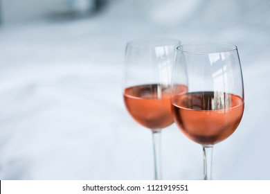 Two glass of rose wine with white background (selective focus)