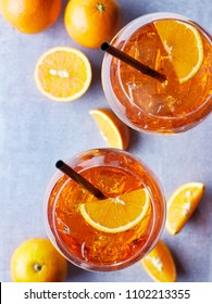 Two glasses of Aperol spritz cocktail with orange slices on marble background. Top view