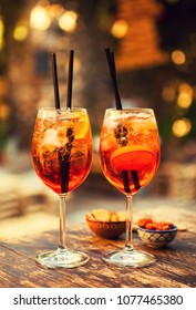 Two glasses of Aperol Spritz cocktails on the table in restaurant, Taormina, Sicily, Italy.