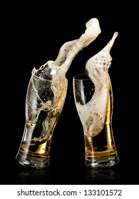 Two glasses with beer up