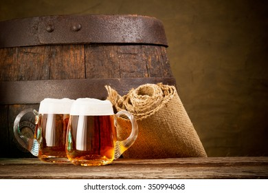 two glasses of beer onthe wooden table