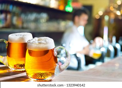 Two glasses of beer in the pub.