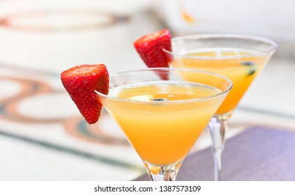 two glasses of Bellini cocktail with prosecco, strawberry decor, Italian bar, traditional aperitif in Milan, aperitif in Florence, tropical citrus cocktail, selective focus, blur, copy space for text