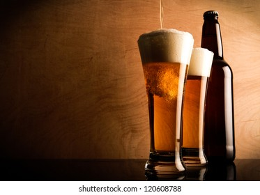 Two glasses and Bottle with Beer on the table