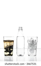 two glasses and a bottle filled with ice, water and oil