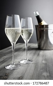 Two glasses of Champagne, Bottle and Cooler; selective focus