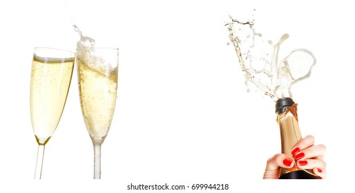 Two glasses of champagne and bottle in hand, with splash, isolated on white background with copy space