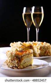two glasses of champagne with cakes