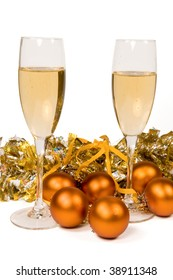 Two glasses  of champagne and Christmas ornament isolated on a white background.