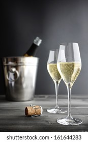 Two glasses of champagne, Cooler and Cork, selective focus